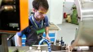 MS Technician Working On A Metal Lathe video