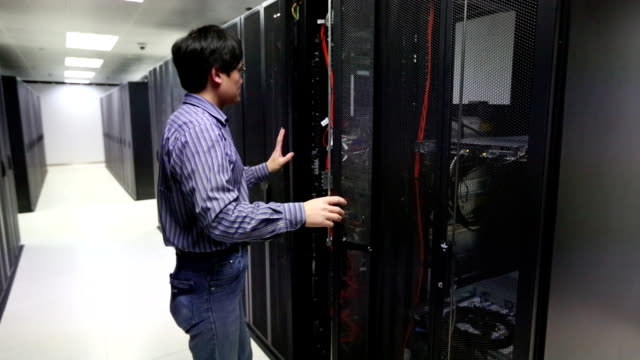 IT Technician working on a server room video