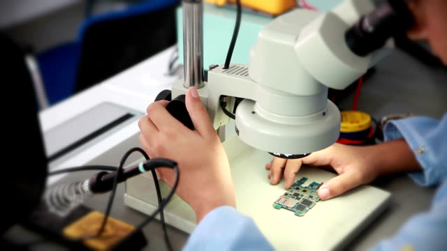 technician working on microscope video