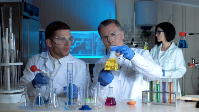 Technologists or scientists in a chemical lab video
