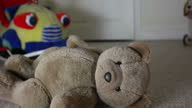 Teddy bear, man leaving room. video