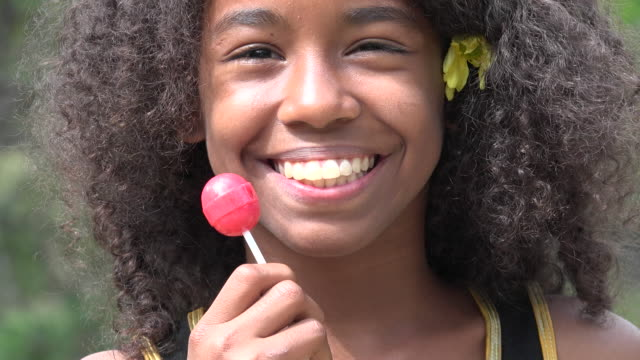 Teen African Girl with Lollipop video