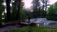Teen boy and girl child standing on the banks of the old pool. Brother and sister are resting in the old park. video