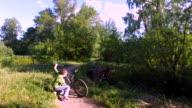 Teen Boy doing his bicycle. Boy examines his bike. video