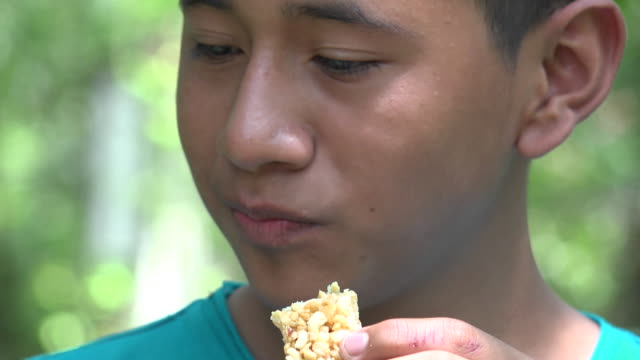 Teen Boy Eating Granola Snack video