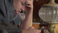 Teen boy on mobile phone video