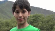 Teen Boy Posing with Mountain video