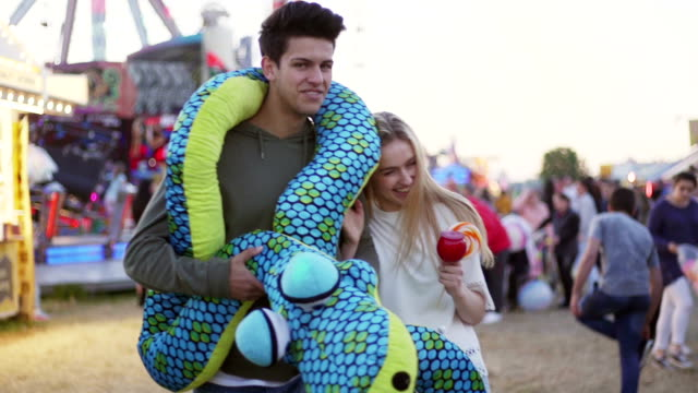 Teen Couple at Amusement Park video