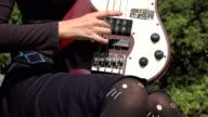 Teen Female Plucking Guitar Strings video