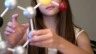 Teen Female Student Studies Science Project - Close Up video