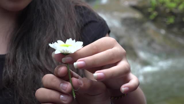 Teen Girl Holding Daisy Flower video