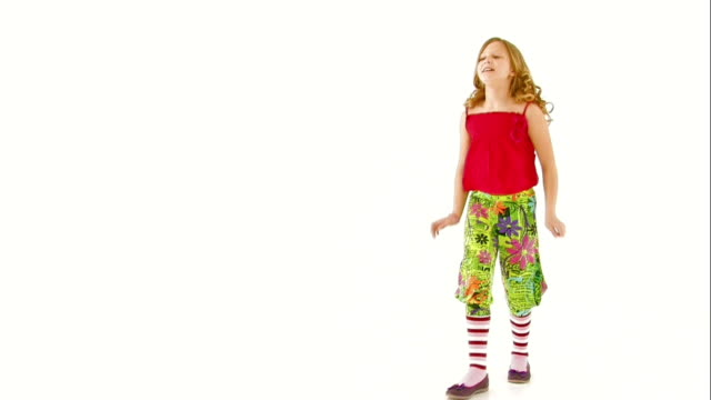 Teen girl is dancing on white background. video