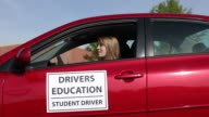 Teen girl learning to drive video