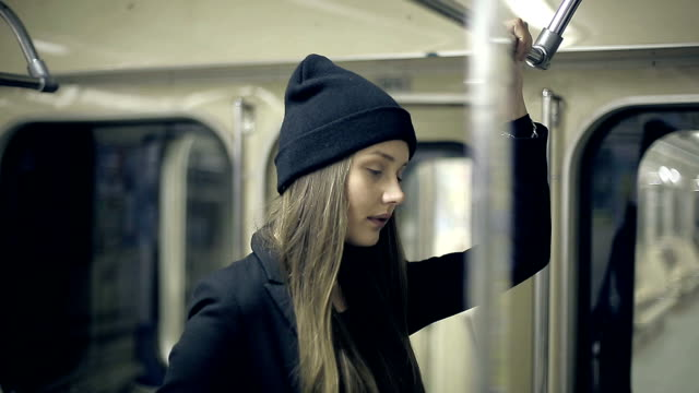 Teen girl rides the metro at night video