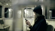 Teen girl rides the subway at night and used smartphone video