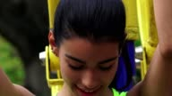 Teen Girl Using Fitness Machine video
