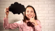 Teen girl with black thinking cloud video