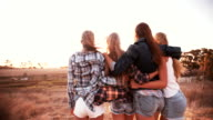 Teen girls facing the sunset with on a summer evening video