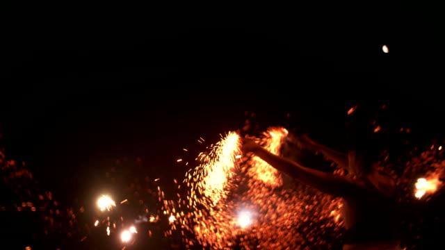 Teen grunge girls dancing with firework flares at night video