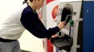 Teen inserts bank card into the ATM and enters PIN video