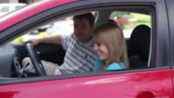 Teen learning to drive car video