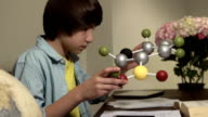 Teen Learns Science by Studying Model of a Molecule CU video