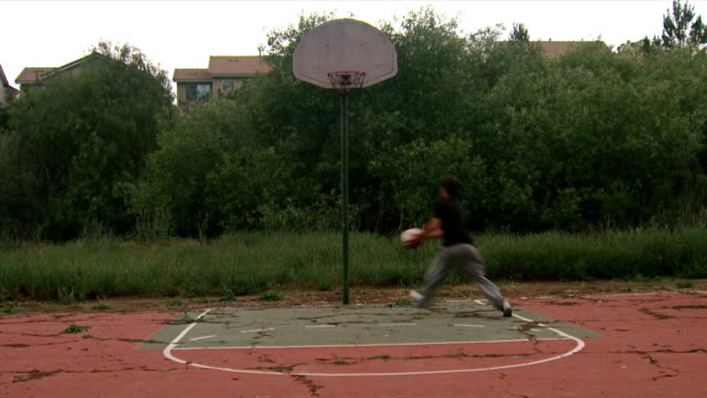 Teen playing basketball montage video