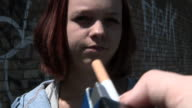 Teen reluctantly takes cigarette video