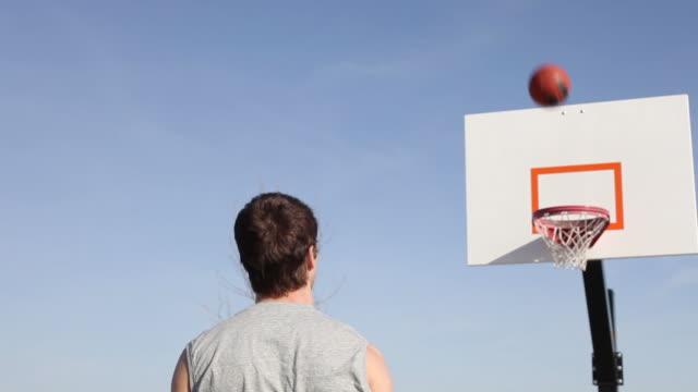 Teen shoots basketball video