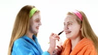 Teen skin care treatment teenage girls applying homemade cream mask on face video