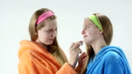 Teen skin care treatment teenage girls with facial cream masks video
