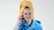 Teen skincare and beauty teenage girl cleans her ear using cotton swab video