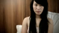 Teenage Asian girl looking at camera and thinking. video