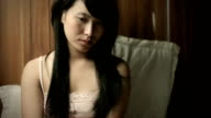 Teenage Asian girl looking down and thinking with blank expression. video