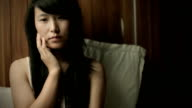 Teenage Asian girl thinking with blank expression. video