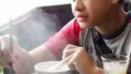 Teenage boy eating rice video