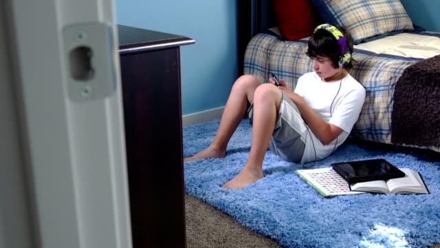 Teenage Boy Listens to Music video