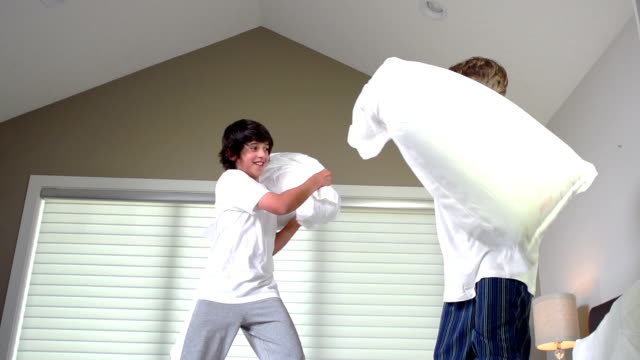 Teenage Boys Having Pillow Fight video