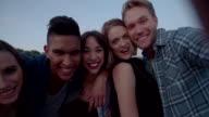 Teenage friends grimacing while taking a selfie video