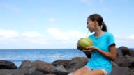 Teenage girl drinking coconut juice video