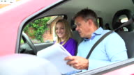 Teenage Girl Having Driving Lesson With Instructor video