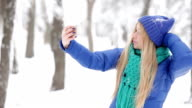 Teenage girl make selfie in winter park video