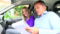 Teenage Girl Passing Driving Test With Examiner video