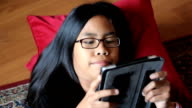 Teenage Girl Plays Game On Her New Digital Tablet video