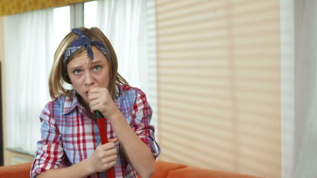 HD: Teenage Girl Singing With A Broom video