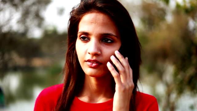 Teenage girl talking on smart phone video