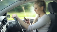 Teenage Girl Texting On Mobile Phone Whilst Driving Car video