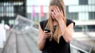 Teenage girl using smart phone video