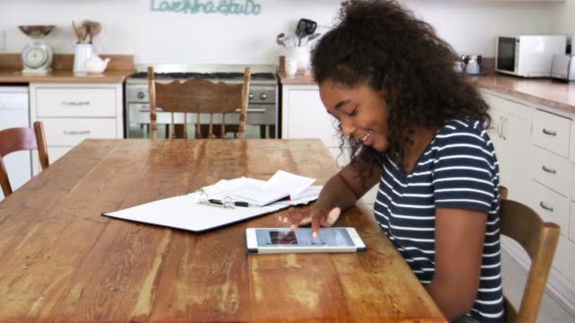 Teenage Girl With Digital Tablet Revising For Exam At Home video
