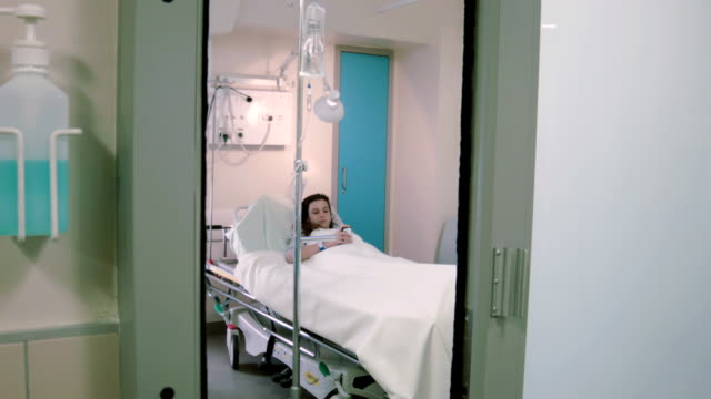 Teenage girl with the phone in the hospital ward video
